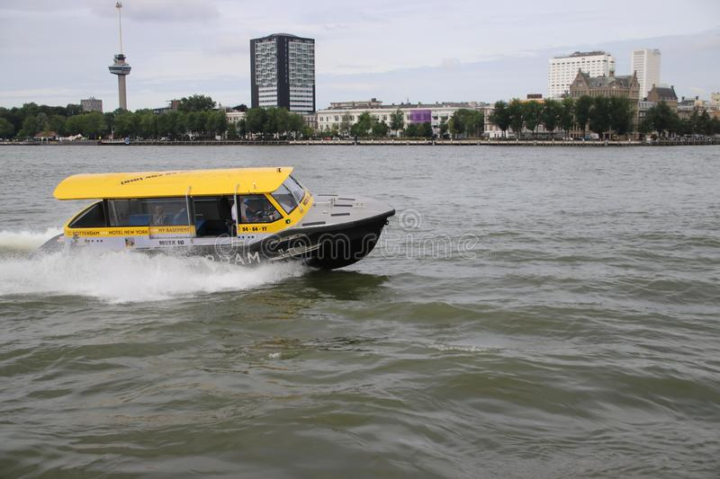 Water taxi with high speed on the river Nieuwe Maas in Rotterdam as fast transport way royalty free stock images