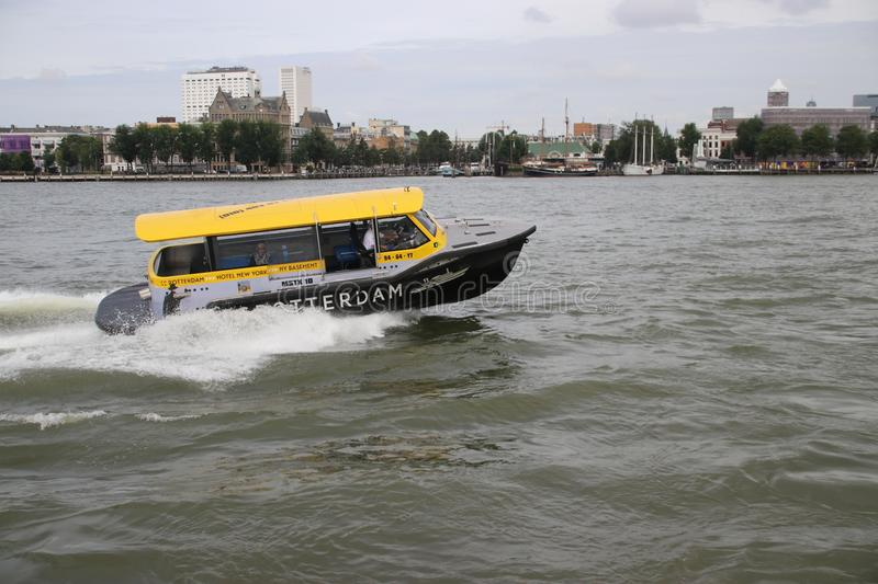 Water taxi with high speed on the river Nieuwe Maas in Rotterdam as fast transport way stock image