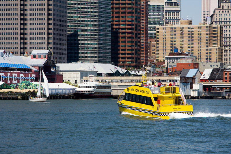 Water Taxi NYC. The New York water taxi as an alternative way of transportation here seen going from Brooklyn's Fulton Ferry landing going to South Street sea royalty free stock photography