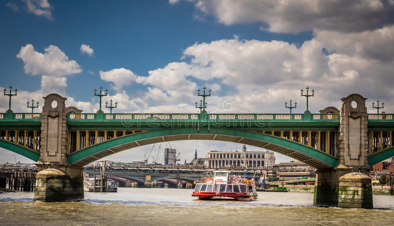 Water taxi under Blackfriars Bridge royalty free stock photo