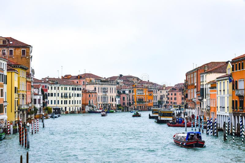 Water Taxis and other boats sailing between Venetian buildings along the Grand Canal in Venice, Italy. royalty free stock images