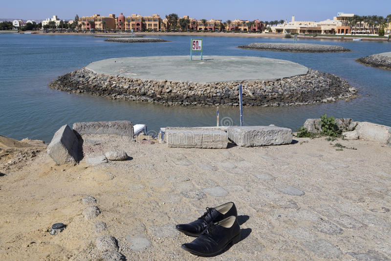 Water testing ground for motor boats and shoes on the bank. El Gouna. Egypt royalty free stock photos