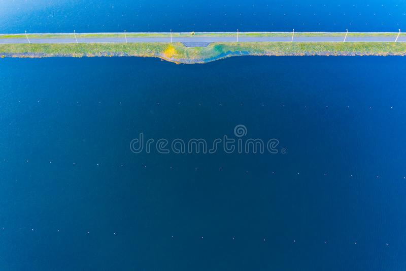Water texture aerial view. Rowing canal on bright day royalty free stock photo