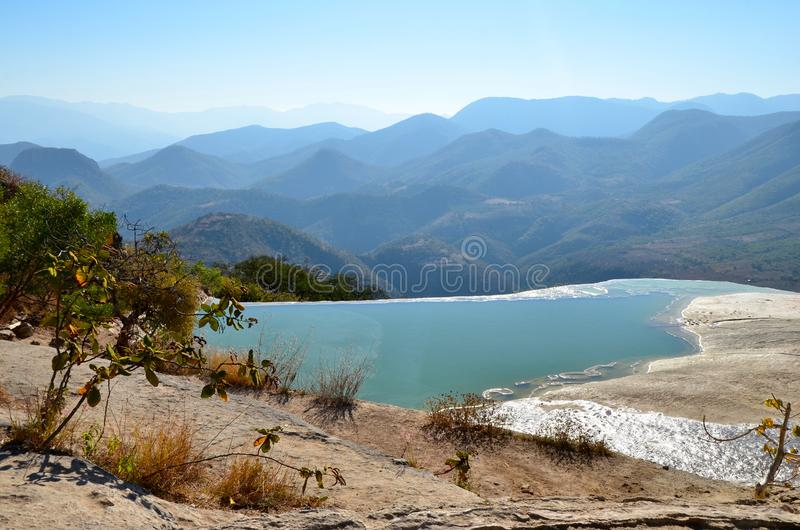 Hierve el Agua, Oaxaca, Mexico. The water at the top of the travertine formations at Herve el Auga, overlooking several ranges of mountains in Oaxaca, Mexico royalty free stock photography