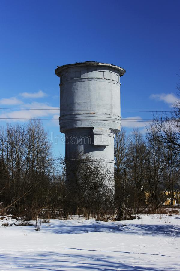 Water tower against a blue sky. vertical arrangement. Water tower against a blue sky. vertical arrangement royalty free stock images