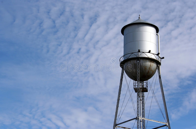Water Tower on a Cloudy Sky stock photography