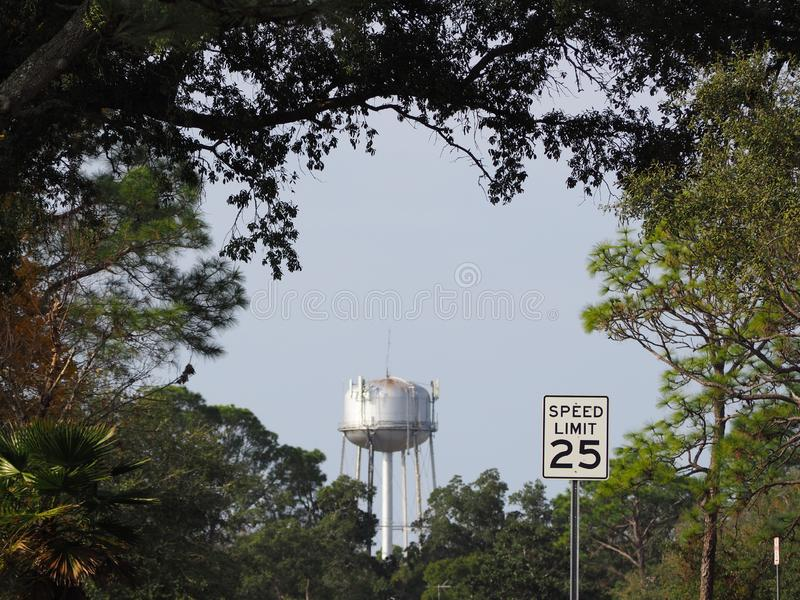 Water tower in distance with speed limit sign. The water tower can be seen from a distance. Speed limit sign is also seen royalty free stock photography