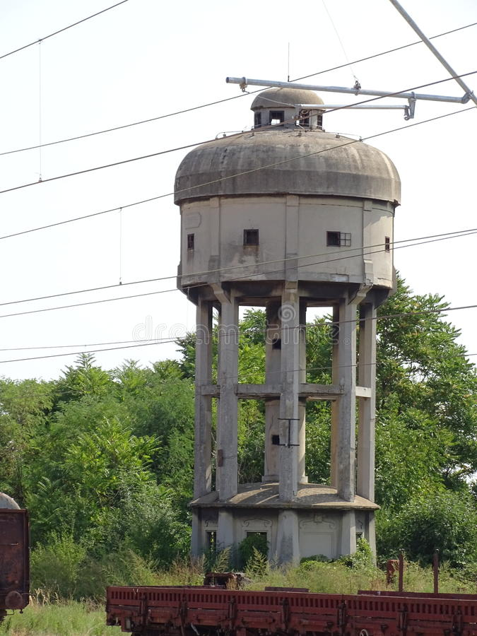 The water tower on the old railway line. The water tower of concrete on the old railway line in railway station Lajkovac in Serbia, an example of an old railway royalty free stock photography