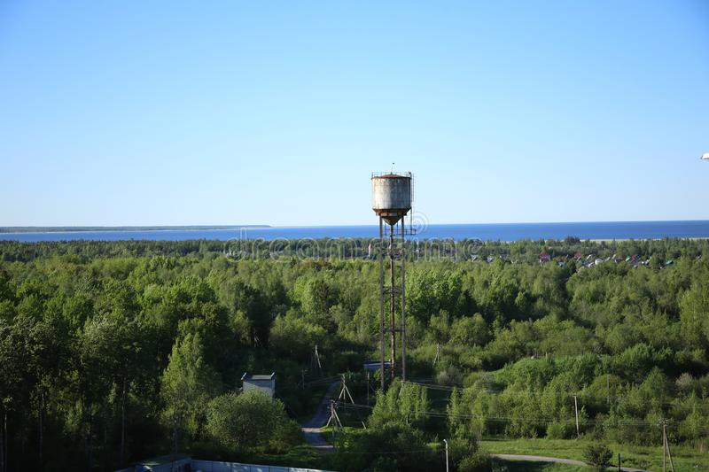 Water tower on the outskirts of the forest stock photography