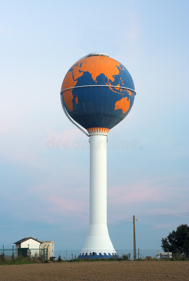 Water tower painted as globe (no aerials). Water tower painted as globe against an early sunset sky (no aerials on top royalty free stock images