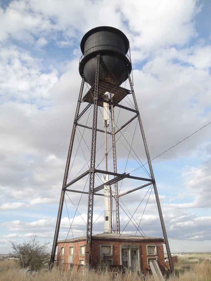 Water tower and pumphouse stock photo