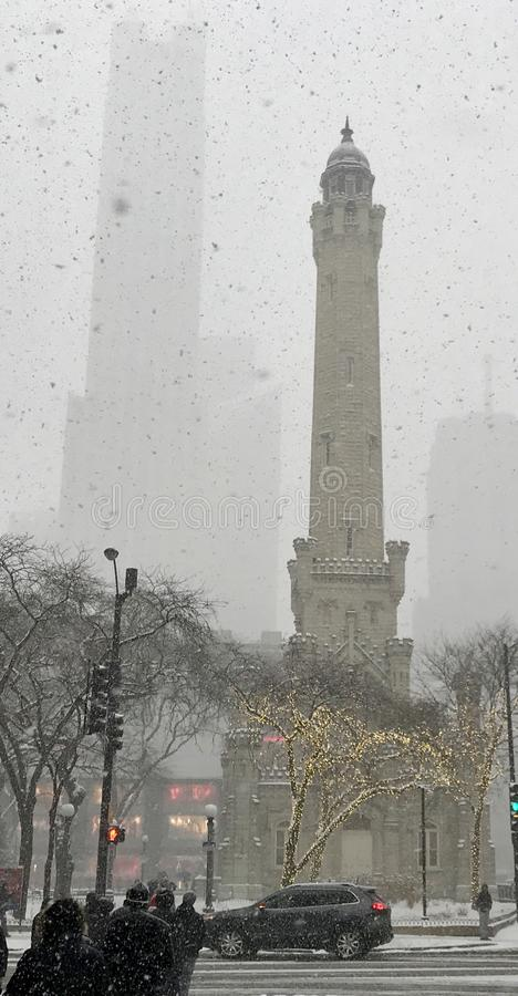 Water Tower in Snow Storm. This is a Winter picture of the historic Chicago WTer Tower in falling snow along iconic Michigan Avenue located in Chicago, Illinois stock images