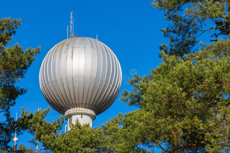 Water tower with a spherical top. STOCKHOLM, TULLINGE - MARCH 16: Spherical top of the water tower in Tullinge. March 16, 2014 in Tullinge, Sweden. Built year stock image