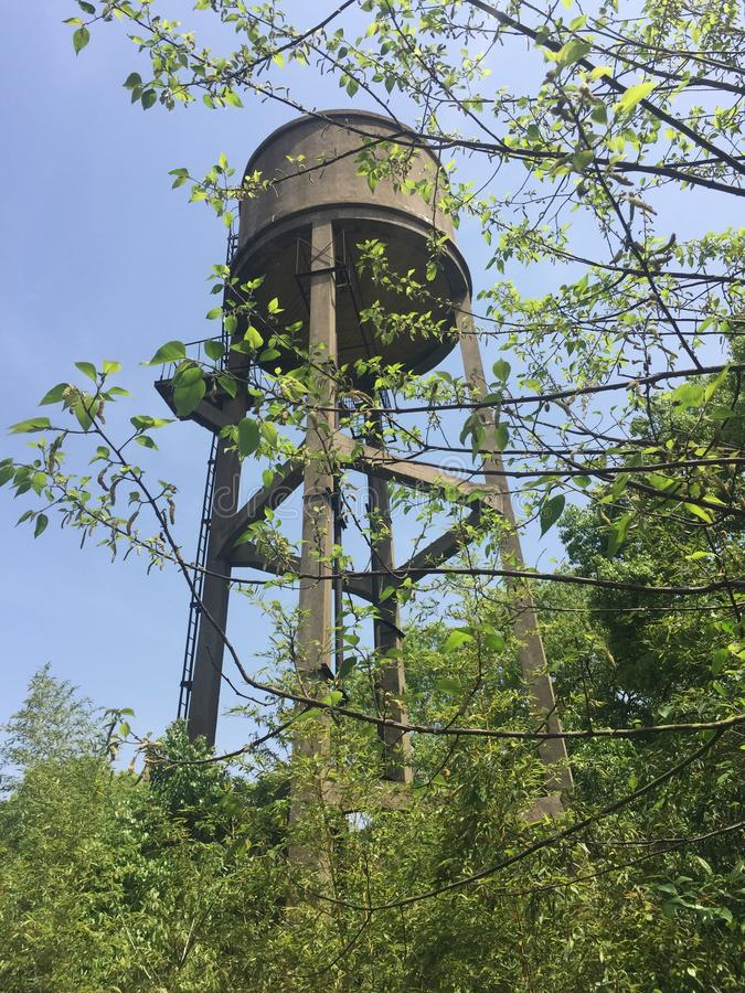 Water tower in spring. Water towers, generally impounding water in residential areas, are also an important part of the water plant's production process royalty free stock photo