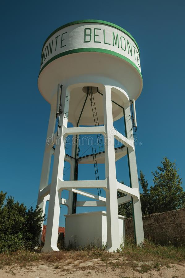 Water tower tank made of concrete. Well maintained water tower tank made of concrete on a small alley, in a sunny day at Belmonte. A cute small town, birthplace royalty free stock images