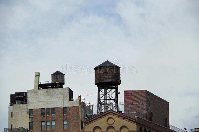 Water towers and buildings. Seen from street in down town nyc royalty free stock image