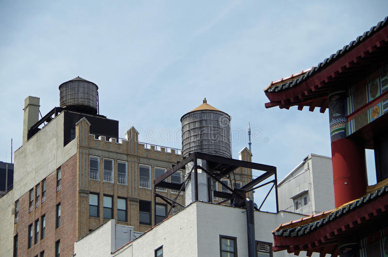Water towers and buildings. Seen from street in nyc stock image