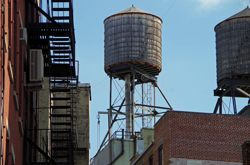 Water towers and rooftops NYC. New York City water towers and rooftops royalty free stock photos