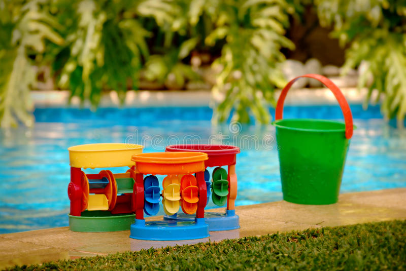 Water toys. Group of water toys by the pool royalty free stock photo