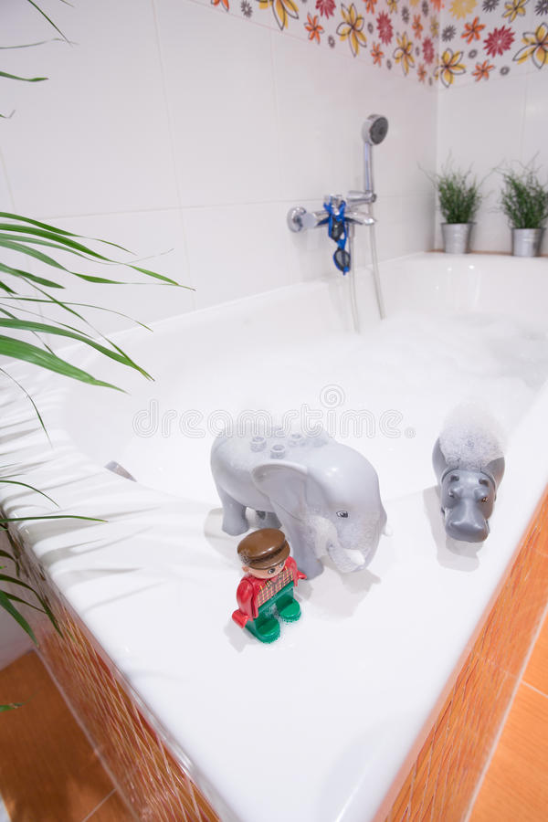 Water toys on bathtub. Close-up of children water toys on the edge of bathtub stock photography