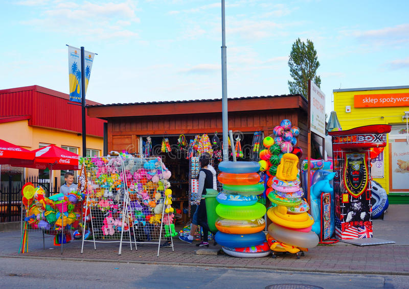 Water toys store. SIANOZETY, POLAND - JULY 20, 2015: Small store by sidewalk offering different water toys stock photos