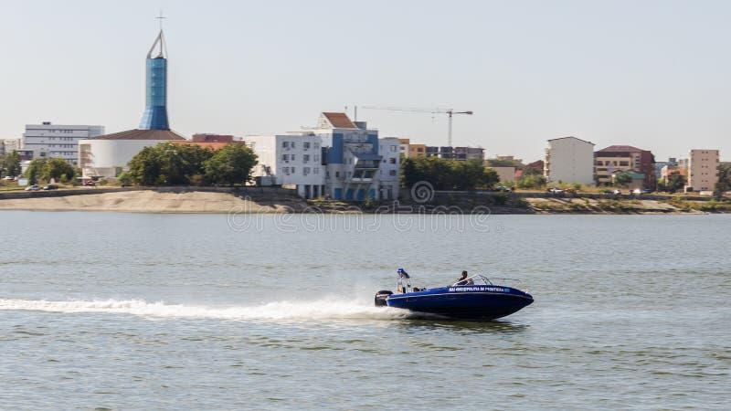 Water traffic interception simulation. By Romanian Ministry of Internal Affairs - Border Police at AeroNautic Show 2013 - Morii Lake, Bucharest royalty free stock photography