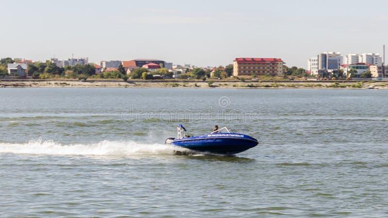 Water traffic interception simulation. By Romanian Ministry of Internal Affairs - Border Police at AeroNautic Show 2013 - Morii Lake, Bucharest stock photos