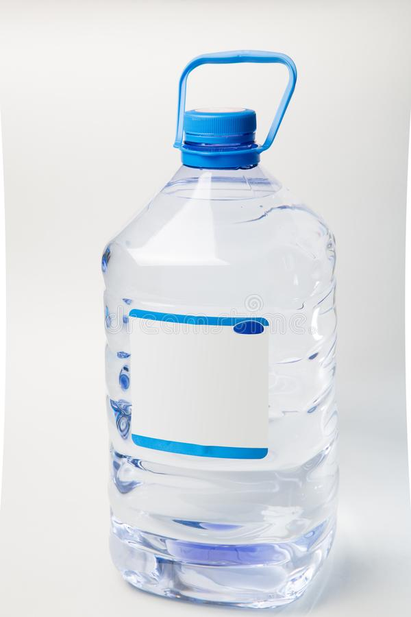 Water in a transparent plastic bottle close-up layout royalty free stock photo