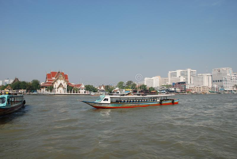 Water transport in the city of Bangkok in Thailand. Boat, river, transportation, long, tail, canal, travel, asia, nature, ship, people, chaophaya, outdoor royalty free stock images