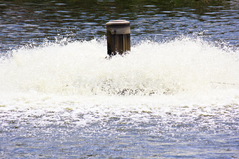 Water treatment by aerator. The water treatment by aerator stock photos