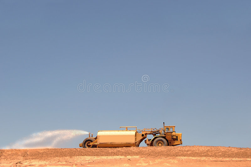 Water truck at construction site royalty free stock photography