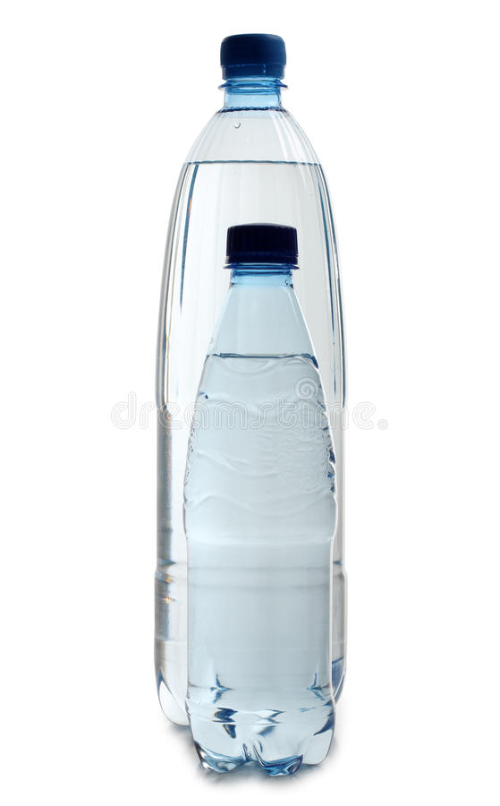 Water in two bottles. Color photo of glasses and bottles of water stock image