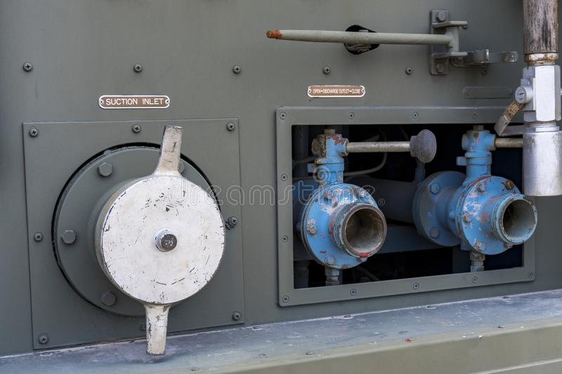 Water valve of military armored car green horse. Military background royalty free stock photo