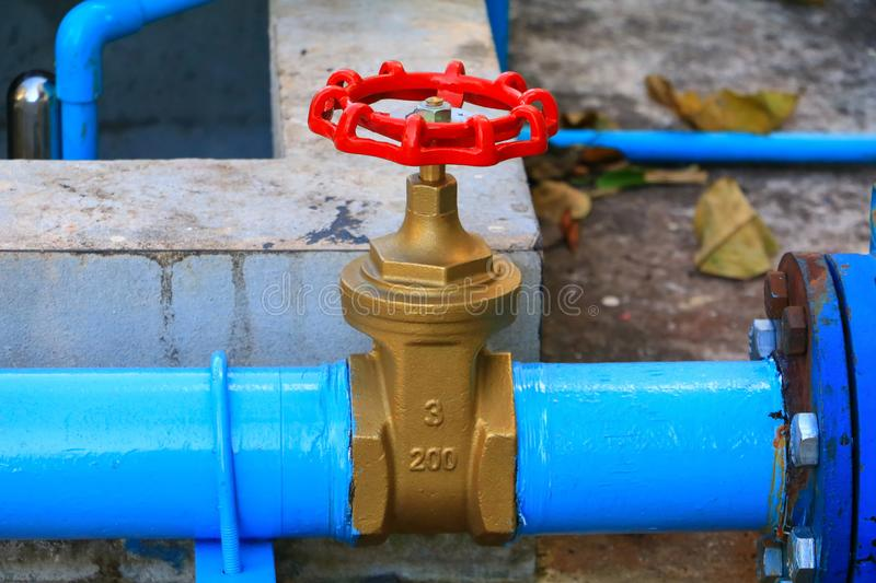 Water valve plumbing joint steel tap pipe with red knob close up.  stock photography