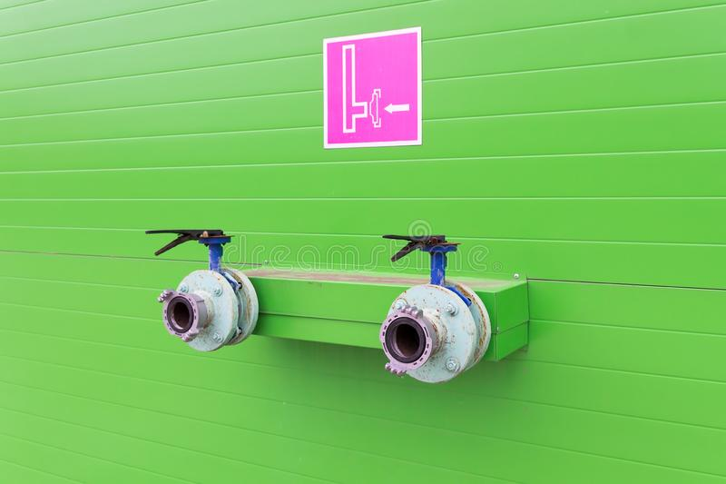 Water valves for Fire protection. Green wall stock photo