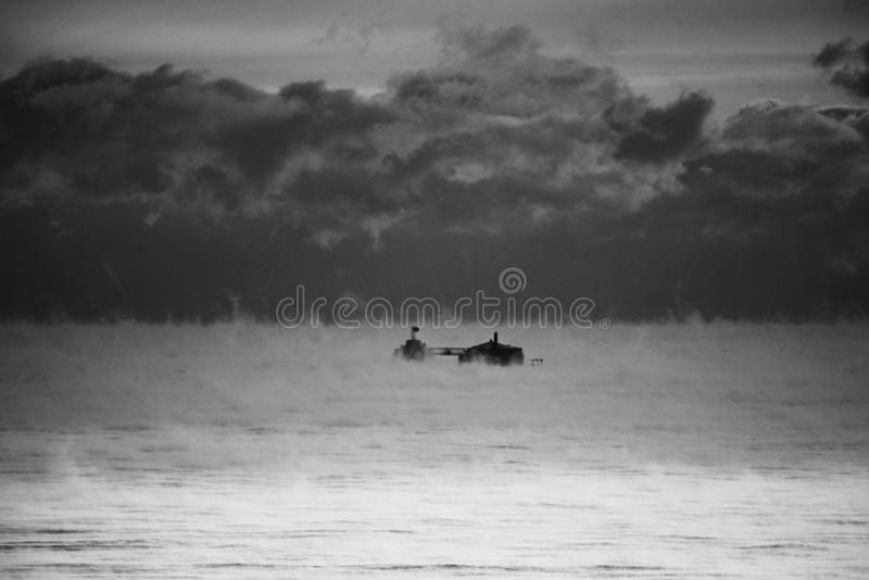 Water Vapors Engulf Water Crib. This is an early morning winter's picture of water Vapors on Lake Michigan engulfing North Avenue Water Crib located in stock image