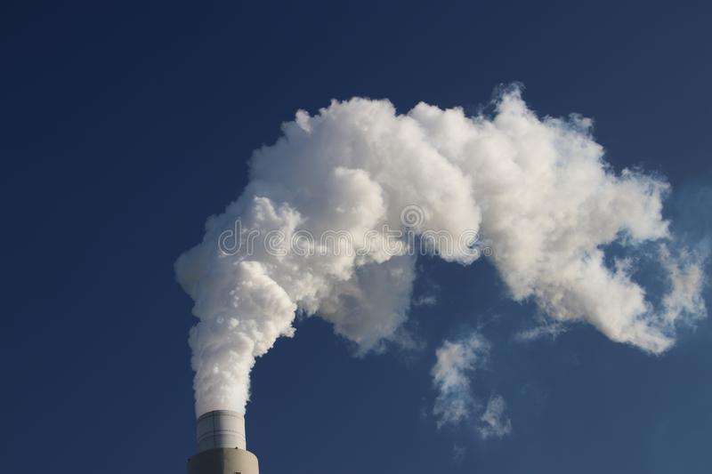 Water vapour coming from the chimney of the coal power plant of Engie on the Maasvlakte harbour in Rotterdam. stock photography