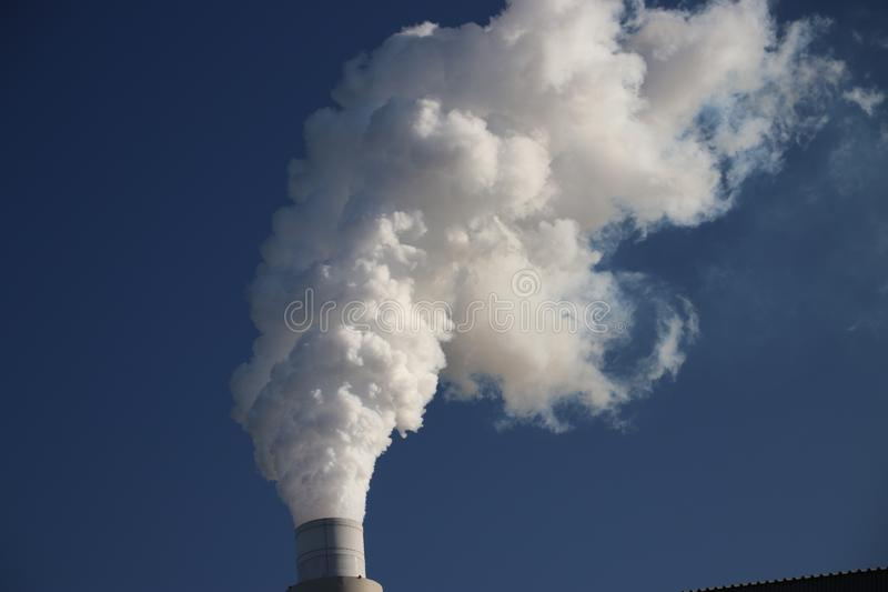 Water vapour coming from the chimney of the coal power plant of Engie on the Maasvlakte harbour in Rotterdam. stock photo