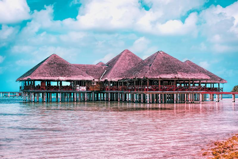 Water Villas at beautiful Maldives island beach resort royalty free stock photography