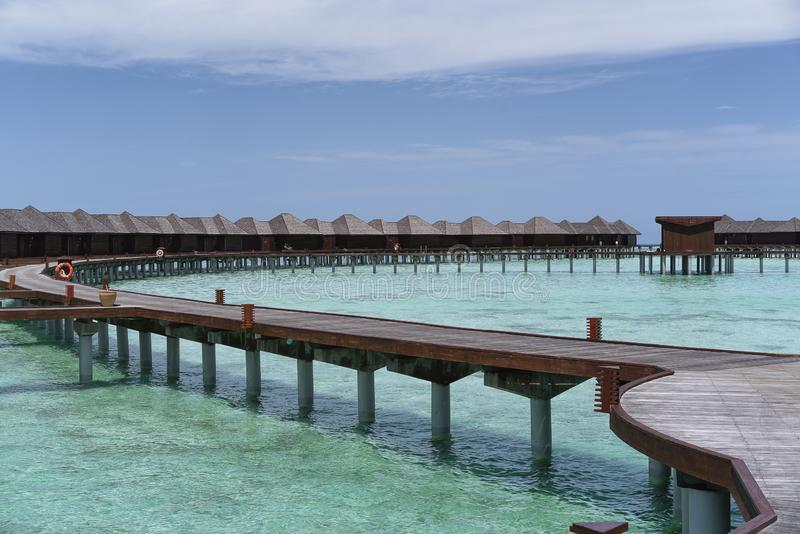 Water villas in Maldives in a sunny day, island paradise relax.  stock photography