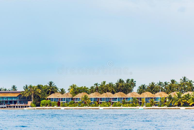 Water villas on tropical caribbean island, Maldives. Copy space for text. Water villas on tropical caribbean island, Maldives. Copy space for text royalty free stock photography