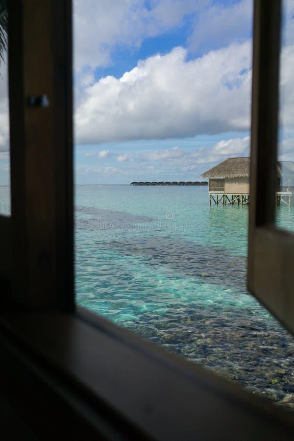 Water villas in tropical Maldives island stock photo