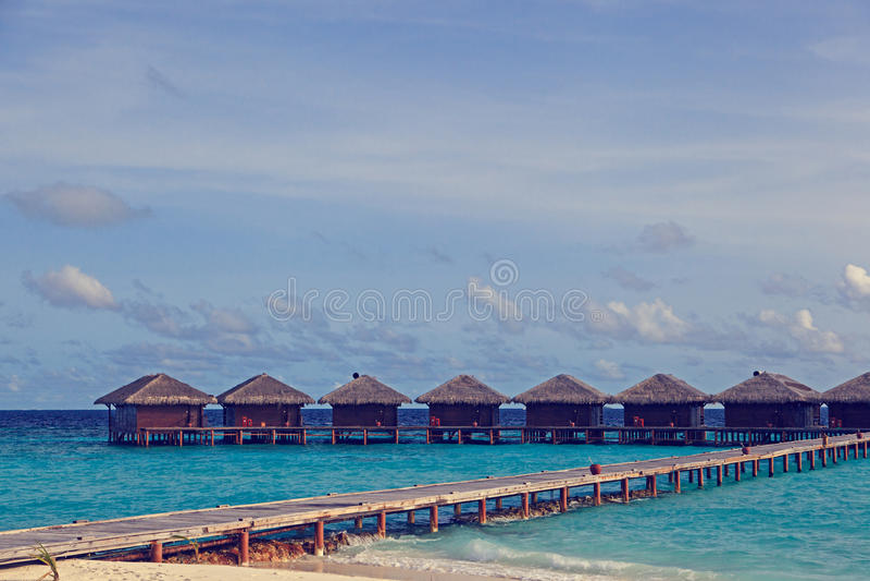 Water villas in tropical resort stock images
