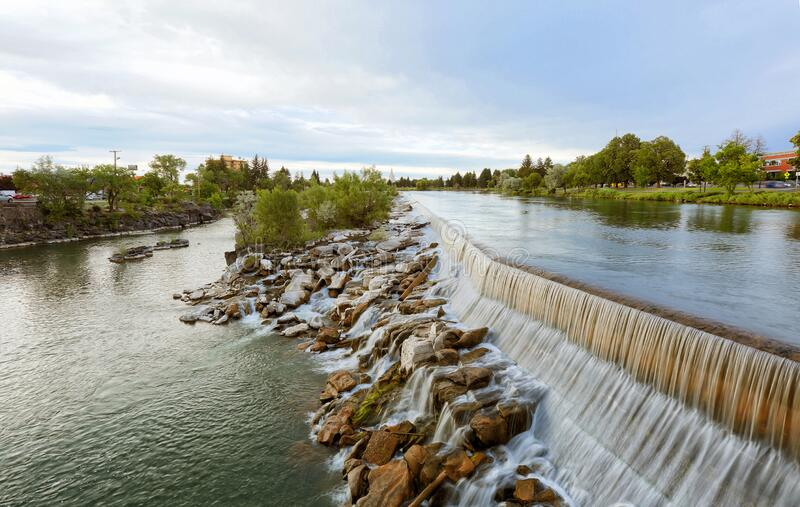 The water water fall that the city of Idaho Falls Idaho is named after. A view of the the Snake river and the water fall that the city of Idaho Falls, ID USA is stock photography