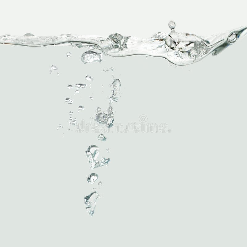 Water wave with air bubbles royalty free stock photo