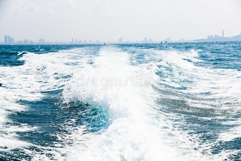 Water waves splash by speed boat daytime ocean sea travel closeup background city royalty free stock photo