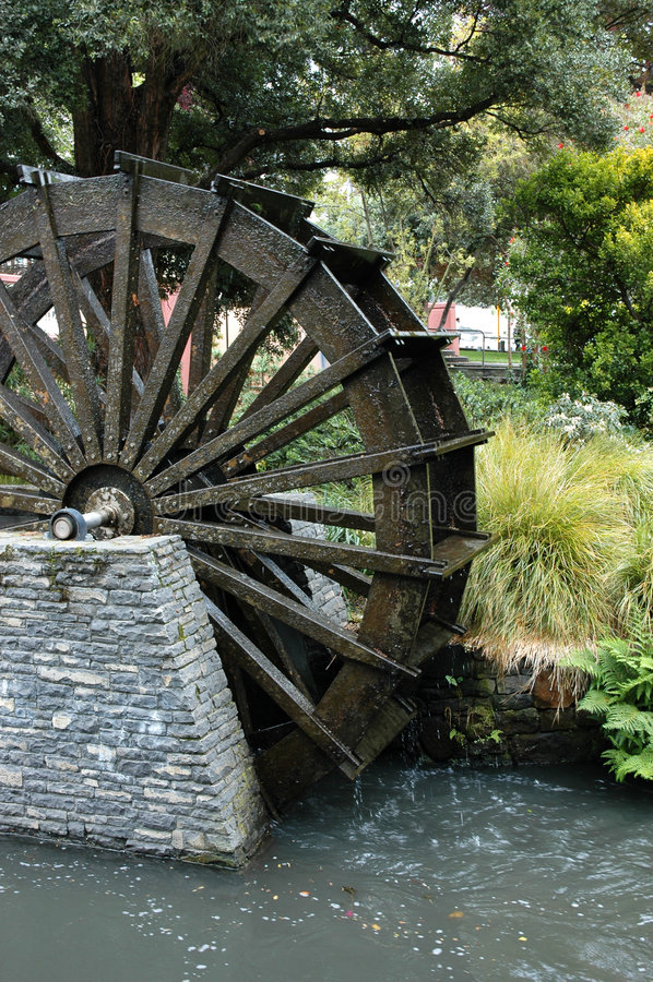 Water Wheel. An old water wheel by the river royalty free stock image