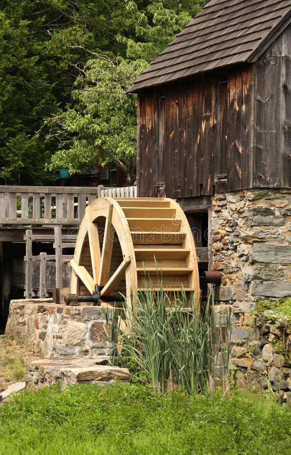 Water wheel. Light brown water wheel for an old wooden sawmill royalty free stock image