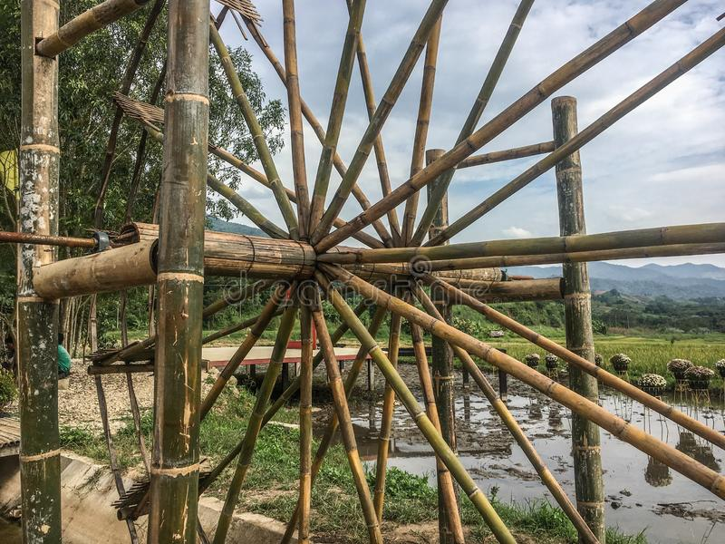Water wheel is an essential agricultural tool that helps locals deliver water from the lower rivers or streams to the higher rice. Paddies for irrigation royalty free stock photos