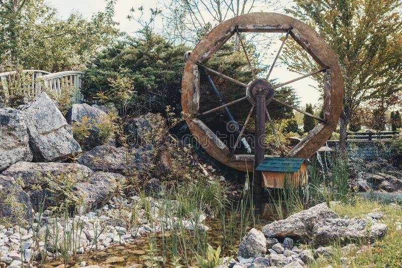 Water wheel mill in village rustic rural area stock image